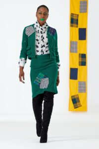 Model wearing clothes designed by Justin Haynes